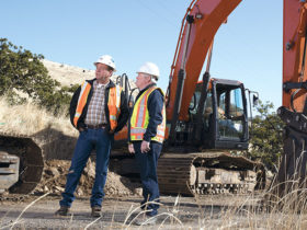 Jim Cooper, Robinson Brothers Construction project manager with Feenaughy Machinery Sales Specialist Byron Rose.