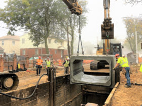 A section of large concrete sewer is lowered into place on Lucas Street between Nashville Boulevard and Williamson Avenue. Photo courtesy of New York City's Department of Environmental Protection.