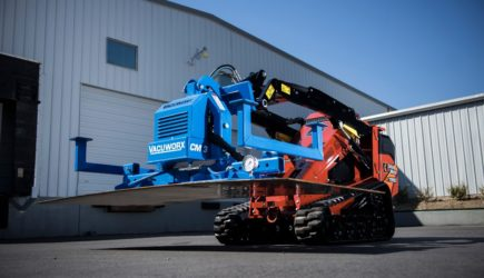 Ditch Witch mini skid steer with Vacuworx's vacuum lifting attachment.