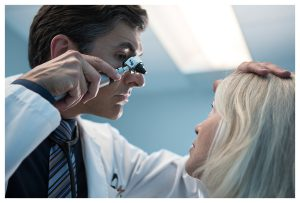 Doctor looking for Cataracts in patients eye