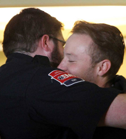 Kyle Woods embraces man who saved him