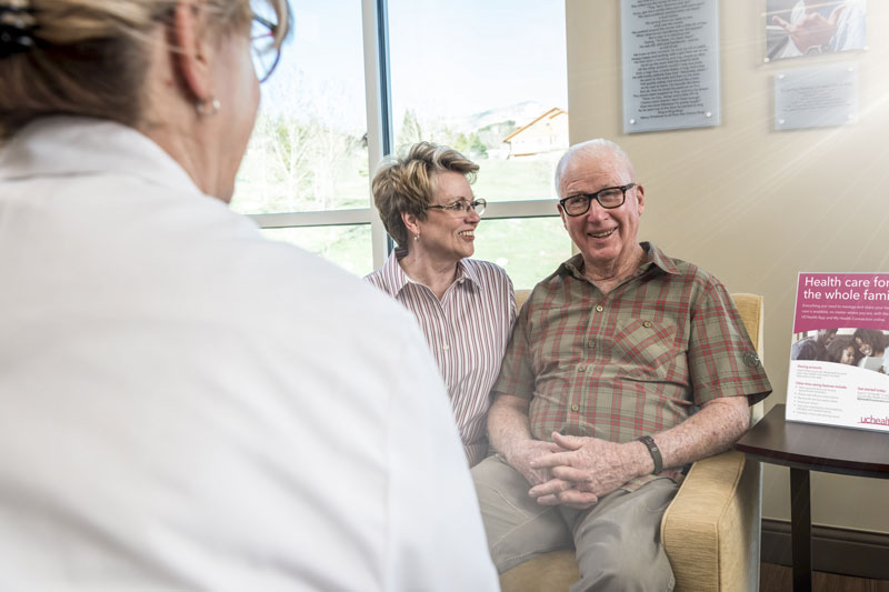 Senior couple consulting with physician | UCHealth