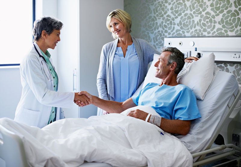 Doctor visit at patient bedside on vascular care page | UCHealth