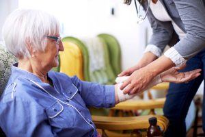 UCHealth EMS member providing at-home care to patient