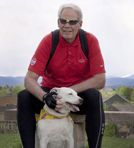 Atrial fibrillation patient Steven Rutledge poses with his dog on a park bench