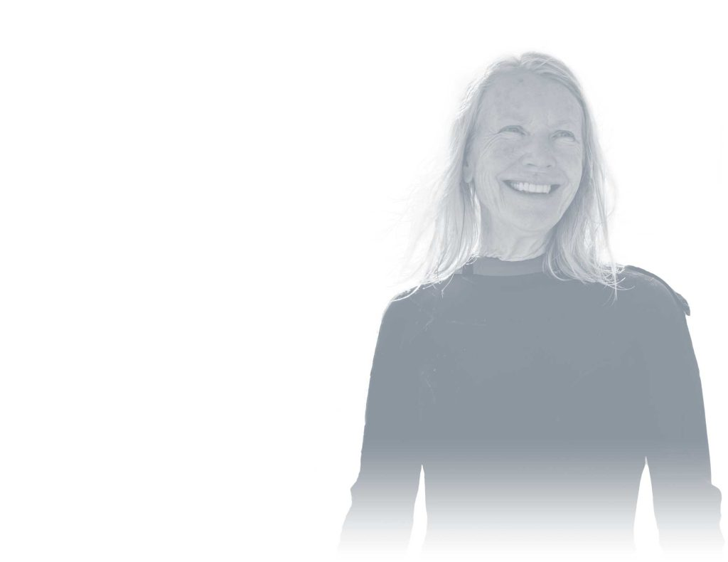 Grey and white photo of a woman smiling - Virtual Visit | UCHealth