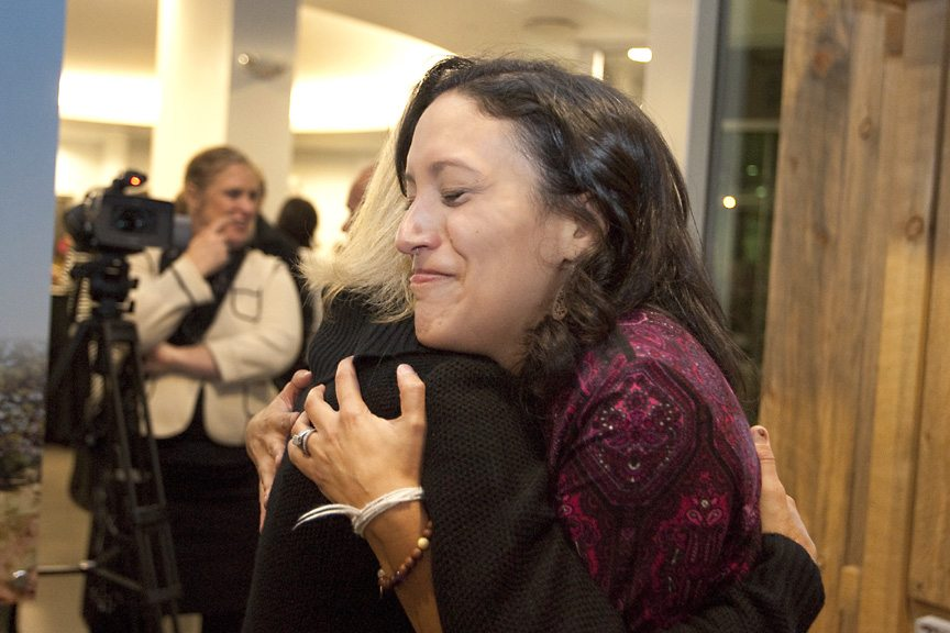 Melinda Peterson hugs Angela Wilson