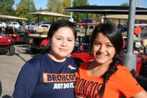 Carmen Washington (left) with her sister Anna before the Oct. 9 game at Sports Authority Field at Mile High.
