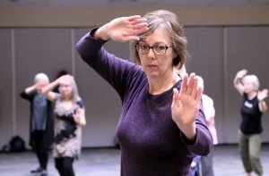 Kelly Mireles practices tai chi during a UCHealth Aspen Club advanced tai chi class in Fort Collins. Photo by Kati Blocker,