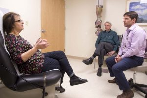 Diane and her husband Dan speak with her doctor, Jonathan Schoen.