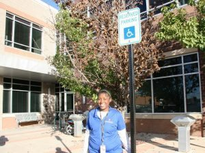 A woman named Joy Jackson poses outside of the UCHealth A.F. Williams clinic in Stapleton.