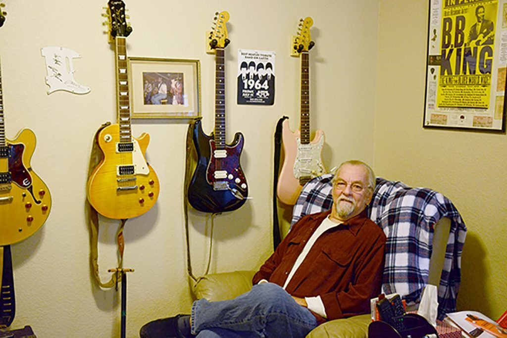 "Martin Gordon of the West Side Rhythm Kings in his ""man cave' with several guitars at his home in Colorado Springs."