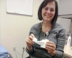 Vicki Ralph uses elastic bandages to wrap lymphedema patients and control their swelling.