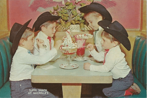 In a photo from 1960, 4 brothers enjoy treats at a soda fountain. They are all wearing cowboy hats.