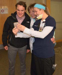 : Charge nurse Kelly Tadken uses her phone for a Facetime session with one of the BMT Unit providers who cared for Lynn Kelly.