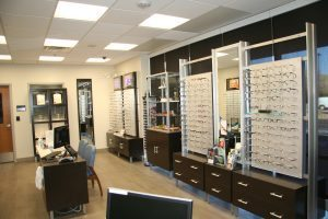 front office of the ophthalmologist with eye glasses displayed on the back wall