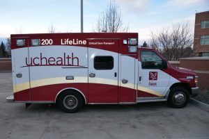 A Falck ambulance, rebranded with the UCHealth LifeLine logo,