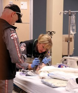 In this photo, Air Link's certified flight registered nurse Leanna Harpman puts a breathing tube into the child simulator's mouth while CFRN Duane Rorie assists.