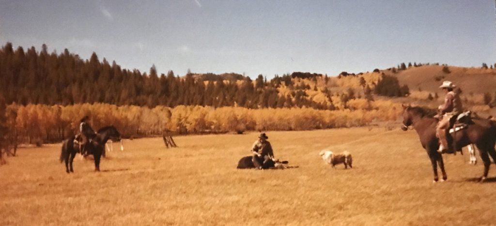 O. Rex Story, far right, helping his family on the ranch in this photo.