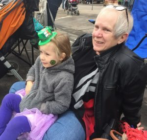 Donna Rose enjoys the Fort Collins' Saint Patrick's Day Parade with her granddaughter.