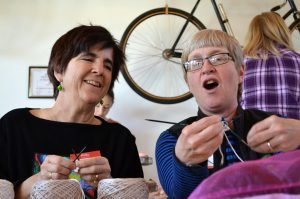 UCHealth physician Barbara Widom respiratory therapist Lori Taylor are shown working side by side on their knitted knockers at the Knit for a Cause Knit-A-Thon at Wolverine Farm Letterpress and Publick House in Fort Collins.