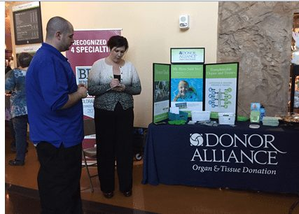 Sundee Gilbert, a donation consultant with Donor Alliance, is shown talking to a gentleman about the importance of organ and tissue donation.