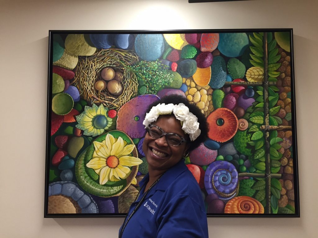 Cynthia Joi Towner, who suffered a stroke at the age of 33, is shown volunteering at UCHealth Memorial Hospital Central.