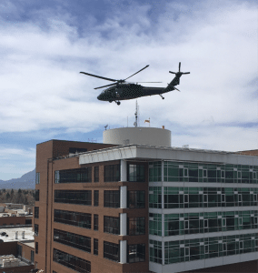 A UH-60 Black hawk helicopter is shown practicing landing on the rooftop helipad at UCHealth Memorial Hospital Central.