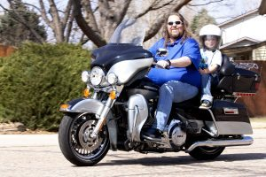 Brian Gary is shown on his motorcycle with his grandson.