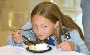 Jase Krantz eats cake.