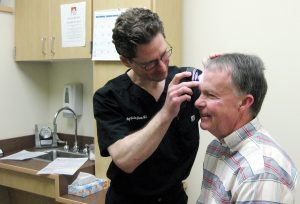 Dr. Andrew Kalajian screenings Phil Sharidan for skin cancer and explains the benefits of annual skin cancer screenings.