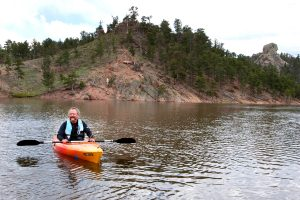 Stan Kepley gets ready to kayak near his home at Curt Gowdy State Park west of Cheyenne, Wyoming.
