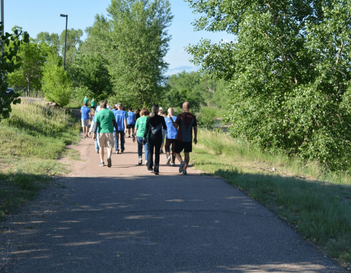 """Dr. Laurence (Larry) Cohen leads a group of walkers along the Pikes Peak Greenway Trail in Colorado Springs. On Sunday mornings, Cohen hosts a """"Walk with a Doc'' outing."""