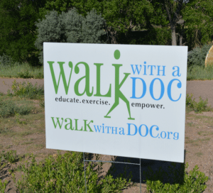 """A picture of a sign that says """"walk with a doc''"""