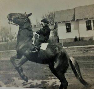 Sara Millard, as a little girl, in a black and white photo.
