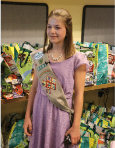 Girl Scout Mackenzie Walton is shown talking about why her troop created gift bags to benefit breast cancer survivors.