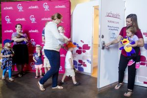 Moms check out nursing pods with their children at the Stadium