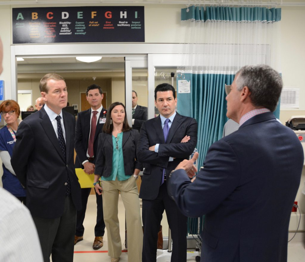 U.S. Sen. Michael Bennet, and Dr. Scott Gottlieb, the commissioner of the U.S. Food and Drug Administration, are shown during a visit to the University of Colorado Hospital emergency department.