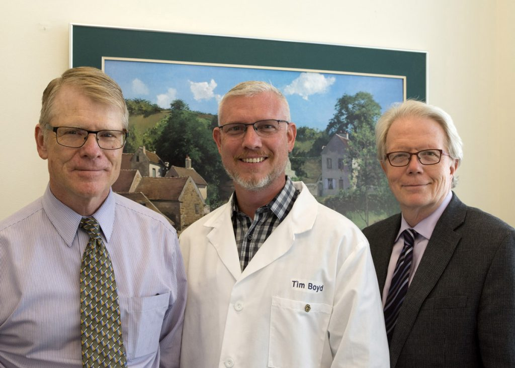 This is a photo of the Rocky Mountain Alzhiemer's Disease Center team leading leukine work and includes Jonathan Woodcock, MD, Tim Boyd, PhD, and Huntington Potter, PhD.