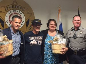 This is a photo of El Paso County Sheriff's Deputy Carlos Gutierrez, Dan Geery, El Paso County Attorney Lisa Kirkman and Sheriff's Lt. J.D. Ross.
