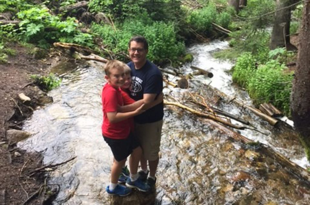 Leland Fay is pictured with his sons at a mountain stream.