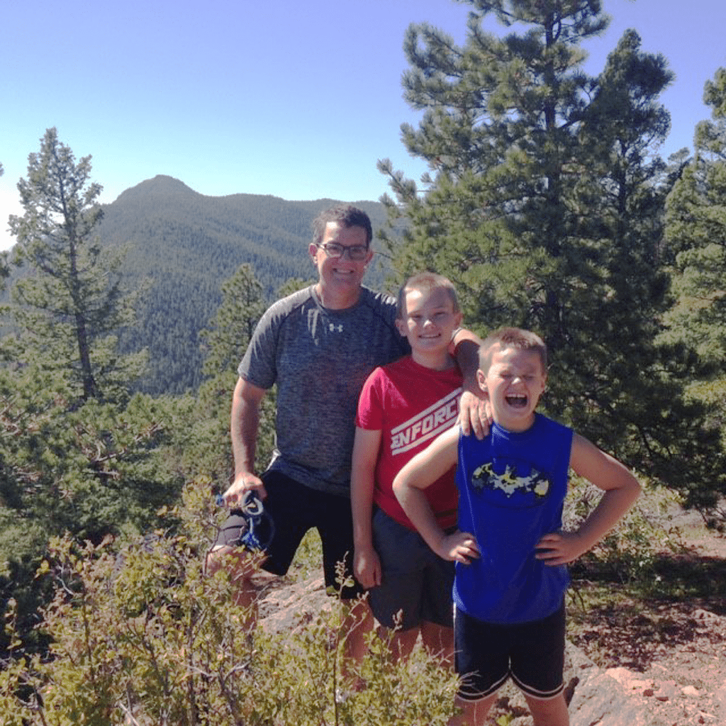 Leland Fay is pictured hiking in the mountains with his two sons.
