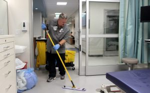 Erich Bowen, an environmental services technician at the new UCHealth Longs Peak Hospital, mops a room in the ER.