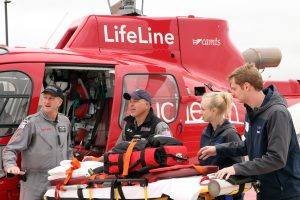 A UCHealth lifeline helicopter crew practices transferring a patient to an ambulance crew at UCHealth Longs Peak Hospital.