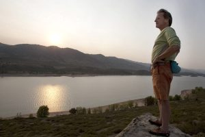 Randy Joseph looking out over Horsetooth Reservoir at sunset.