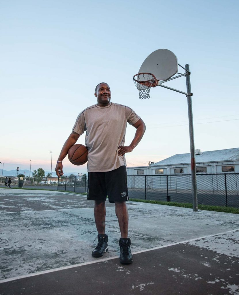 Jandl Scott poses on an outdoor basketball court. Dotors were able to save his legs after a terrible car accident.
