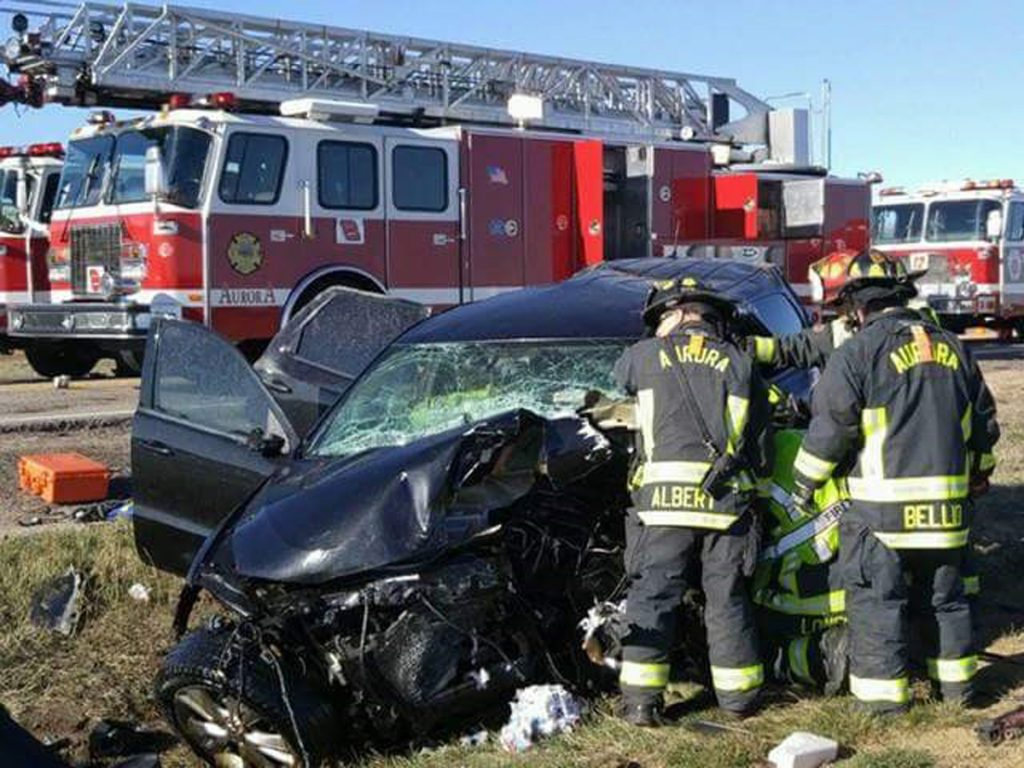 This picture shows Jandl Scott's smashed Dodge Durango. In the background, you see a firetruck and several firemen are right near the wrecked Durangeo.