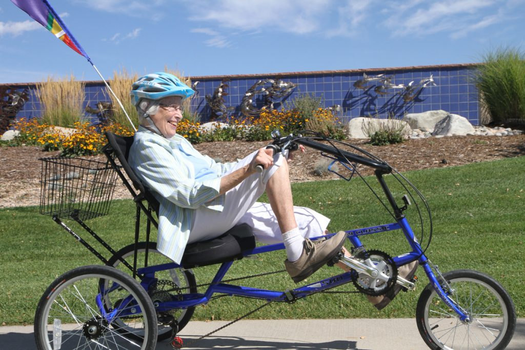Barbara Kansteiner riding her bike with the help of medical massage therapy at UCHealth.