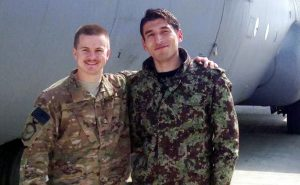 Staff Sgt. Kyle Sanchez, left, with an Afghan solider who he helped train for the Afghan Air Force airlift mission that provided relief operations to the country.