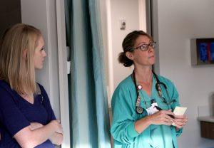 N Staci Eggen stand right of Amanda Edson as she shows soon-to-be parents around the new birth center.